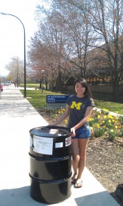 U of M Art School student Diane Thach with donated steel Drum