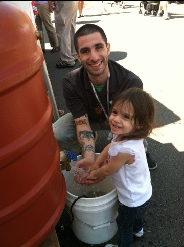 Joshua and Jasmine play in the rain barrel display!